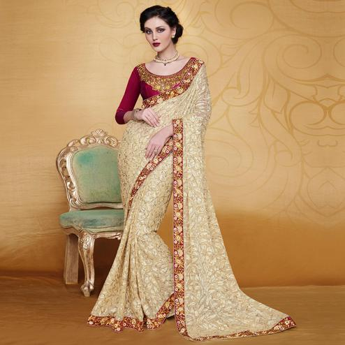 Engrossing Beige Colored Partywear Embroidered Brasso Saree