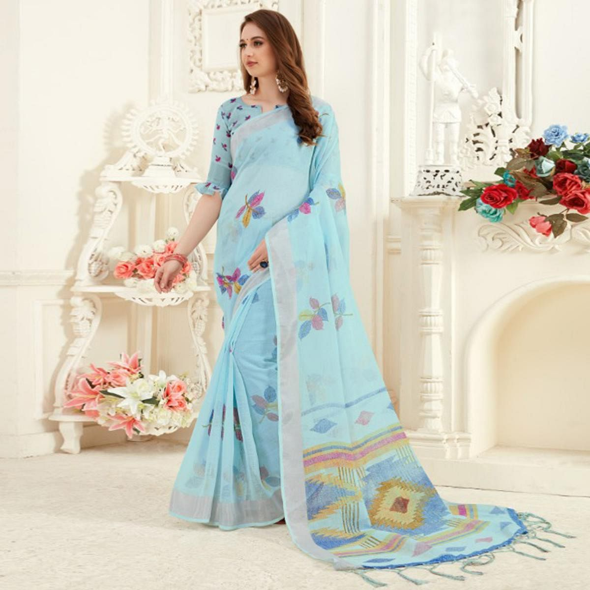 Radiant Light Blue Colored Casual Printed Linen Saree With Tassels