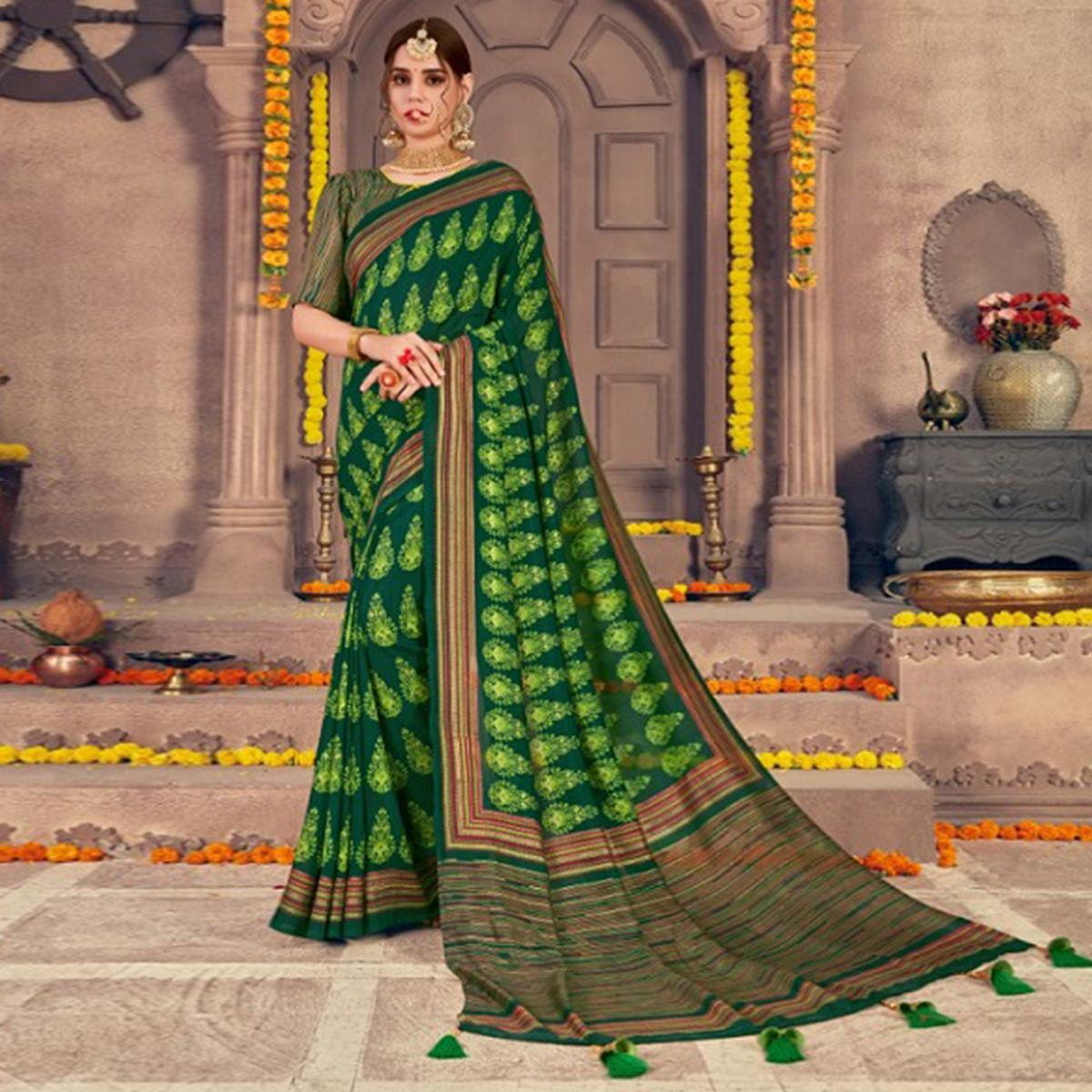 Flamboyant Green Colored Festive Wear Printed Georgette Saree With Tassels