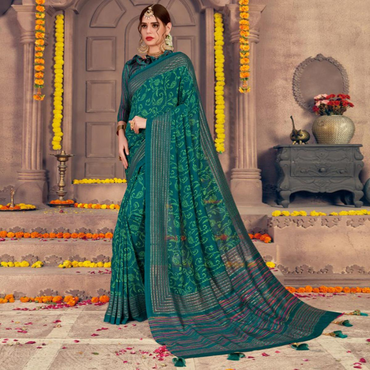 Pretty Teal Green Colored Festive Wear Printed Georgette Saree With Tassels