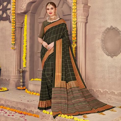 Flaunt Dark Green Colored Festive Wear Printed Georgette Saree With Tassels