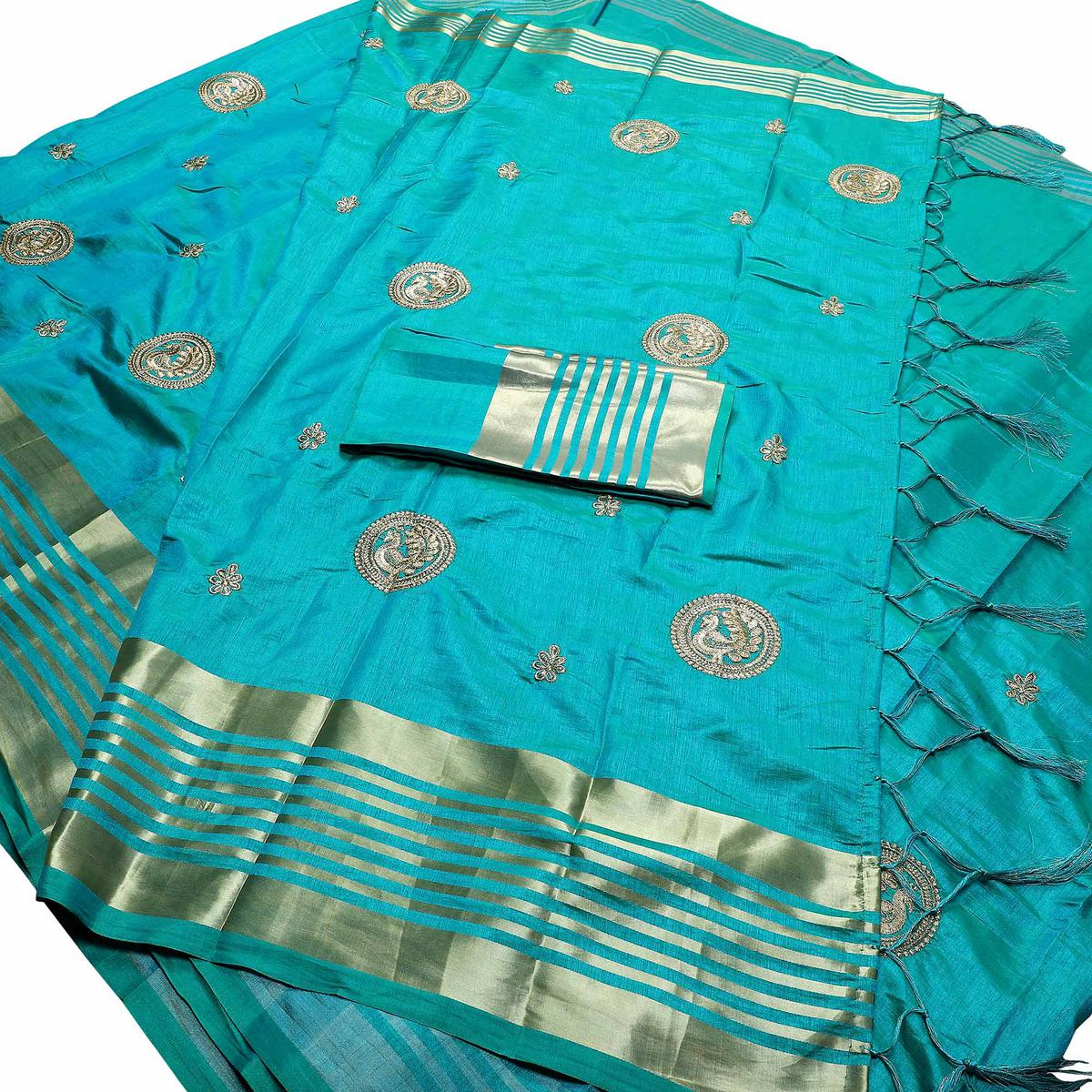 Appealing Sky Blue Colored Festive Wear Peacock Embroidered Banarasi Silk Saree With Tassels