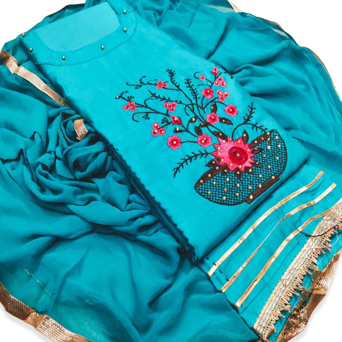 Hypnotic Sky Blue Colored Partywear Floral Embroidered Cotton Dress Material