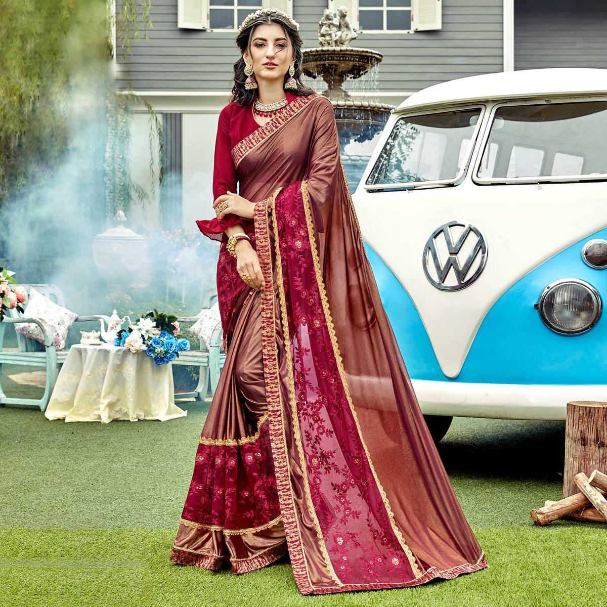 Marvellous Maroon Colored Partywear Embroidered Lycra Saree