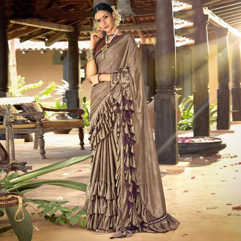 Entrancing Brown Colored Partywear Ruffled Lycra Saree