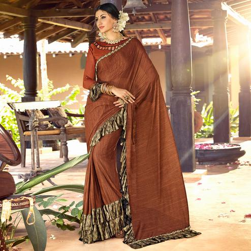 Sophisticated Brown Colored Partywear Ruffled Lycra Saree