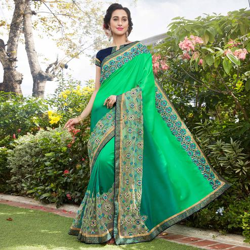 Magnetic Green Colored Partywear Embroidered Georgette Saree