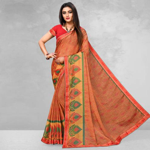 Arresting Orange Colored Casual Wear Printed Brasso Saree