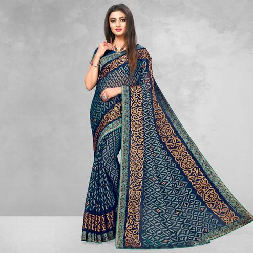 Exotic Navy Blue Colored Casual Wear Printed Brasso Saree