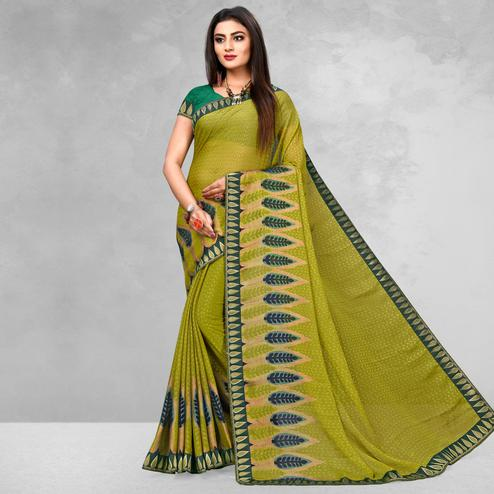 Elegant Olive Green Colored Casual Wear Printed Brasso Saree