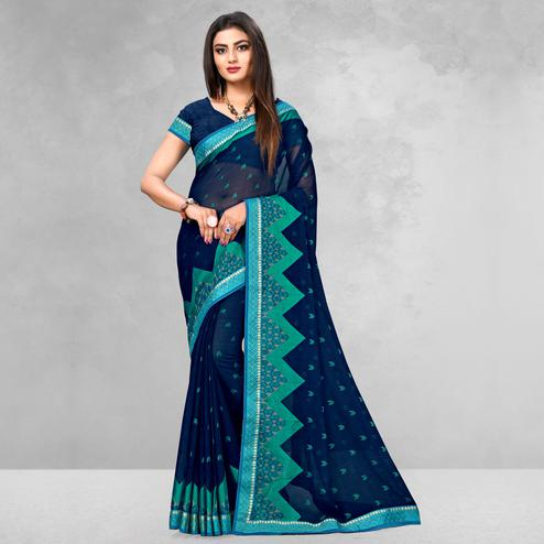 Opulent Navy Blue Colored Casual Wear Printed Brasso Saree