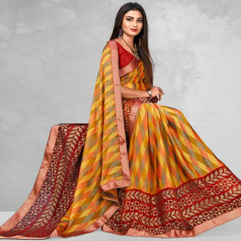 Magnetic Yellow Colored Casual Wear Printed Brasso Saree