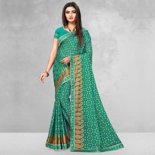 Flattering Turquoise Green Colored Casual Wear Printed Brasso Saree