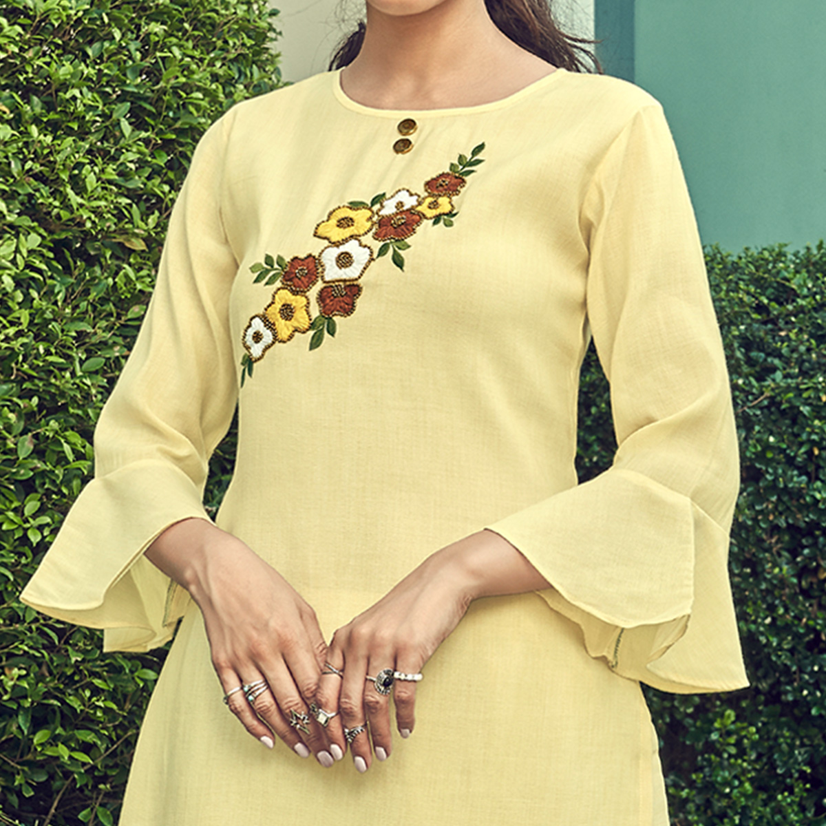 Demanding Yellow Colored Partywear Floral Embroidered Cotton Kurti-Palazzo Set