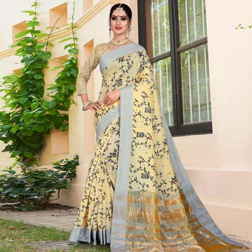 Elegant Light Yellow Colored Casual Printed-Woven Linen Saree With Tassels