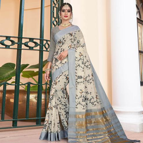 Pleasant Off White Colored Casual Printed-Woven Linen Saree With Tassels