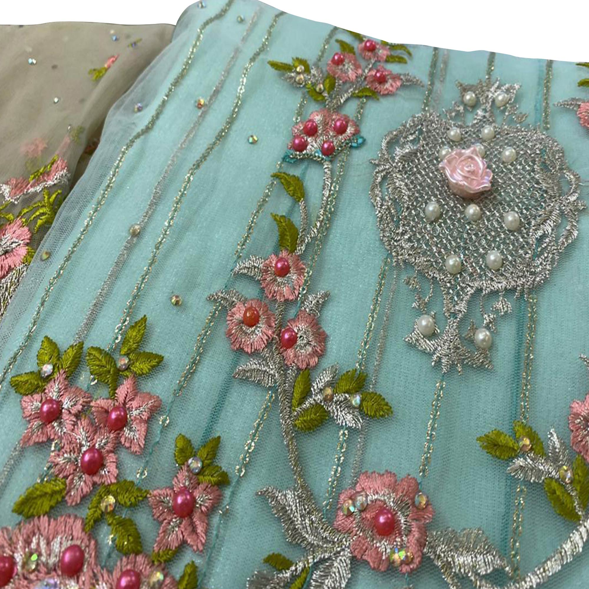 Appealing Mint Green Colored Partywear Embroidered Netted Lehenga Kameez