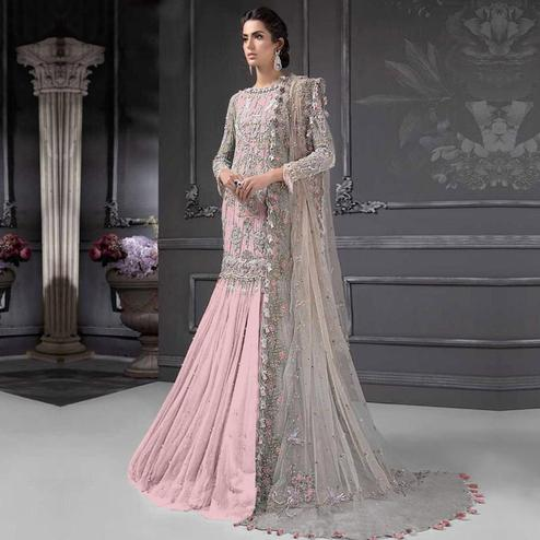Capricious Pink Colored Partywear Embroidered Netted Lehenga Kameez