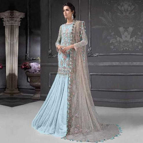 Entrancing Sky Blue Colored Partywear Embroidered Netted Lehenga Kameez