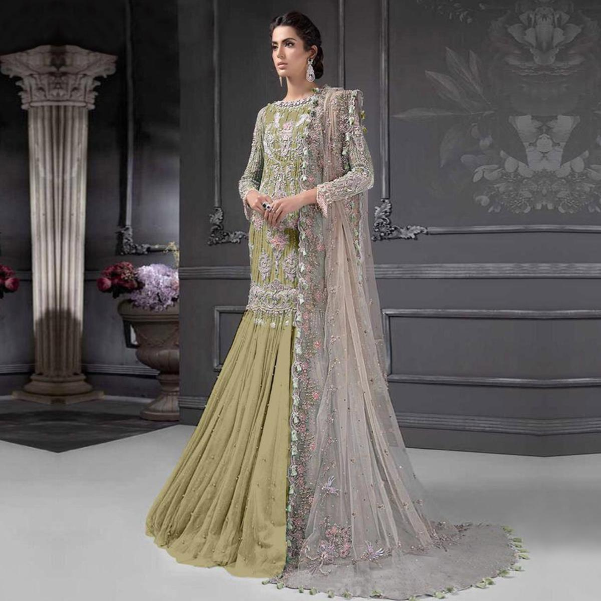Groovy Olive Green Colored Partywear Embroidered Netted Lehenga Kameez