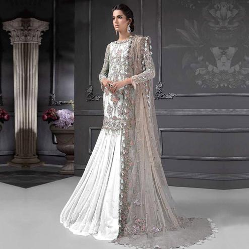 Adorning White Colored Partywear Embroidered Netted Lehenga Kameez