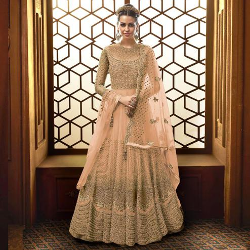 Impressive Peach Colored Party Wear Embroidered Netted Anarkali Suit