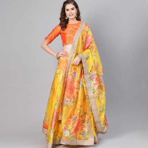 Adorning Yellow Colored Partywear Floral Printed Organza Lehenga Choli