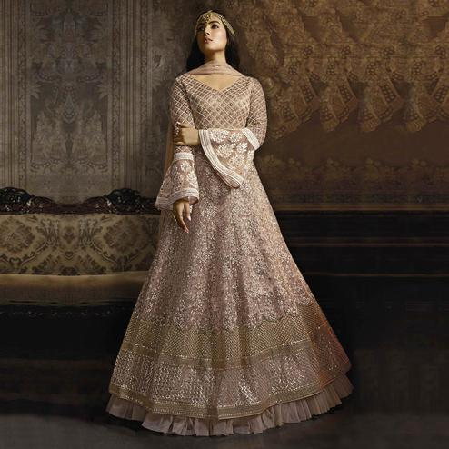 Pleasant Light Pink Colored Partywear Embroidered Bell Sleeve Net Anarkali Suit