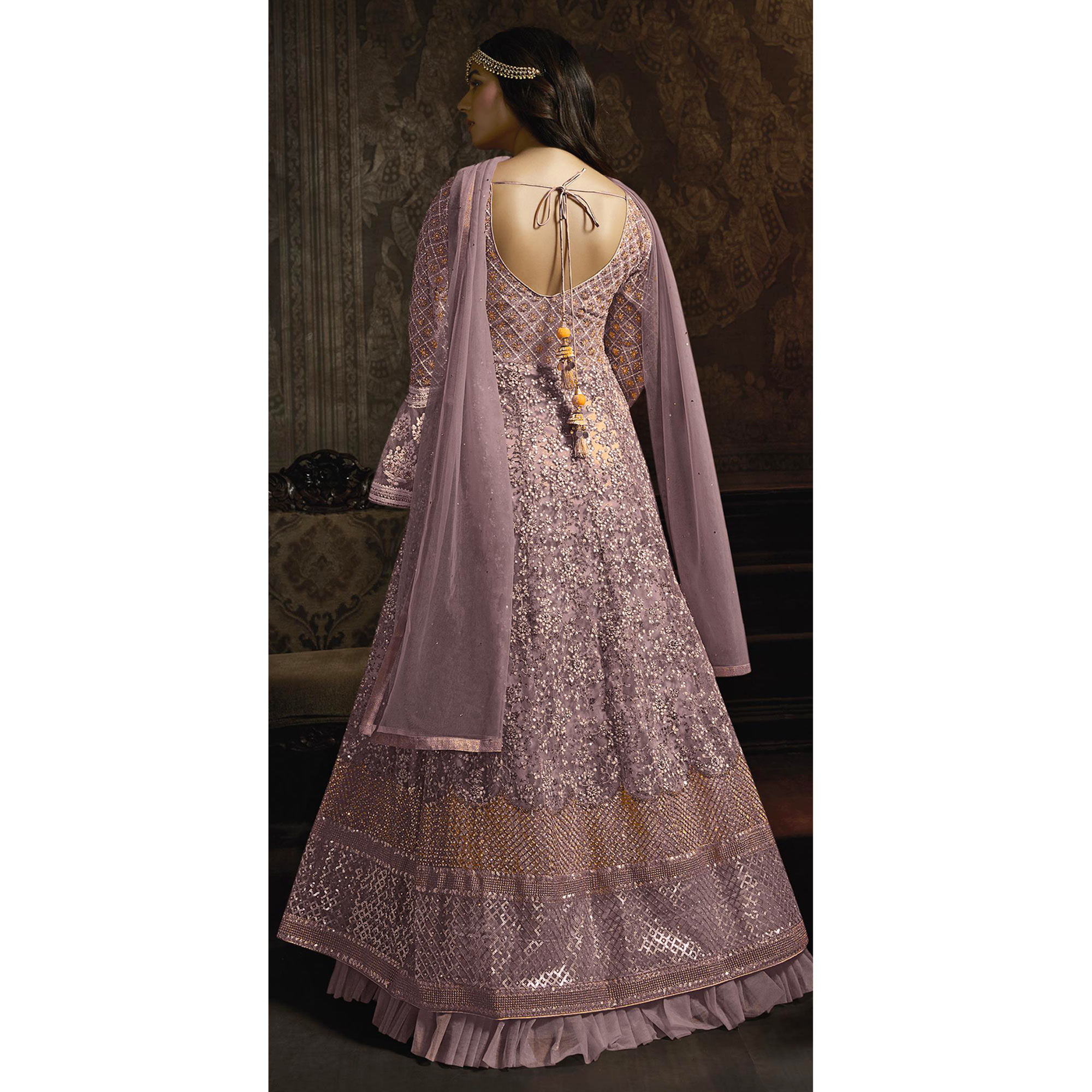 Opulent Lavender Colored Partywear Embroidered Bell Sleeve Net Anarkali Suit