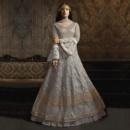 Energetic Grey Colored Partywear Embroidered Bell Sleeve Net Anarkali Suit