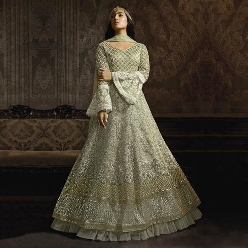 Glowing Light Green Colored Partywear Embroidered Bell Sleeve Net Anarkali Suit