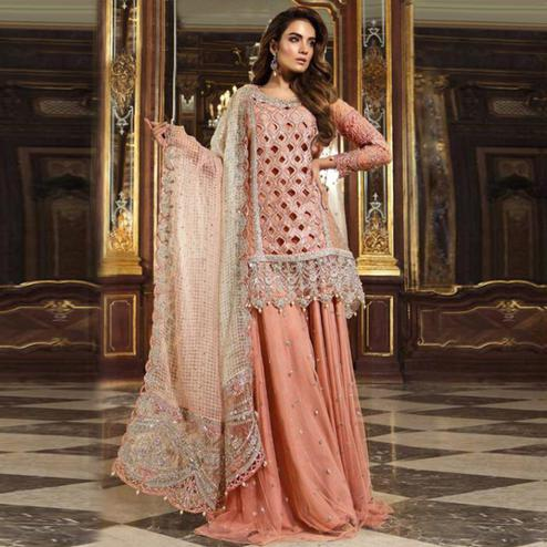 Eye-catching Peach Colored Partywear Embroidered Net Palazzo Suit