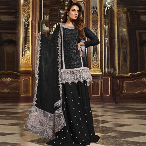 Impressive Black Colored Partywear Embroidered Net Palazzo Suit