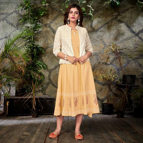 Arresting Beige Colored Partywear Printed Cotton Long Kurti With Embroidered Jacket