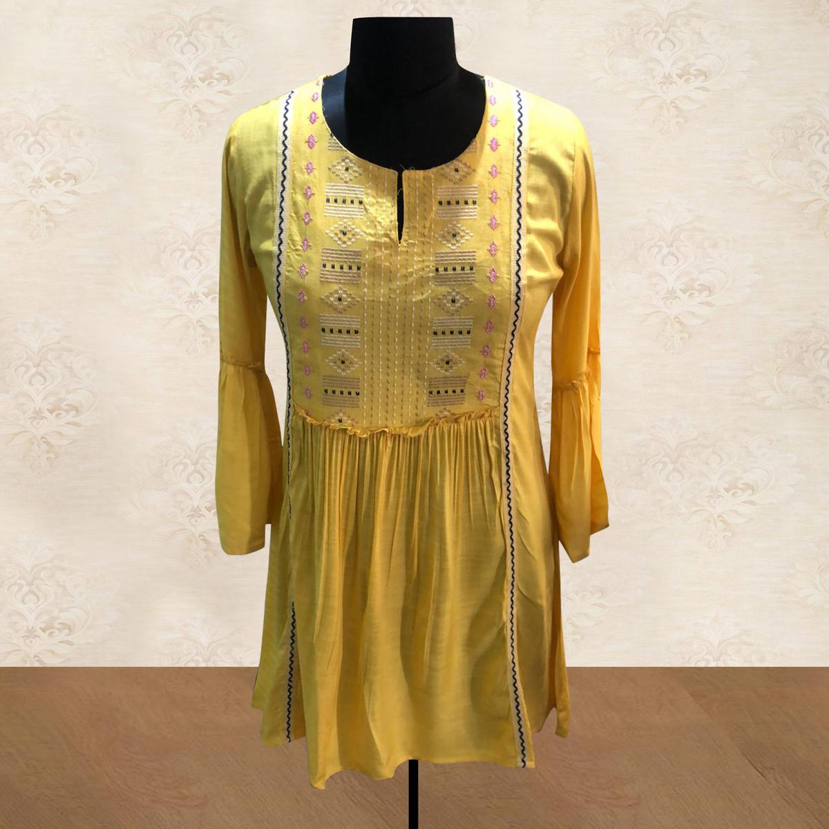 Glowing Yellow Colored Partywear Embroidered Cotton Short Kurti