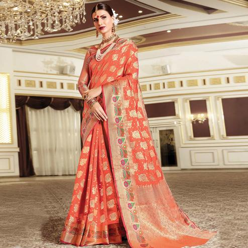 Flamboyant Dark Peach Colored Festive Wear Woven Silk Saree