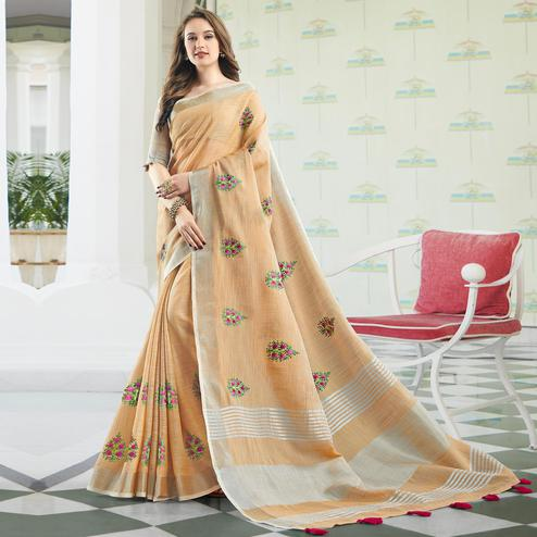 Adorable Light Peach Colored Party Wear Floral Embroidered Linen-Cotton Saree With Tassels