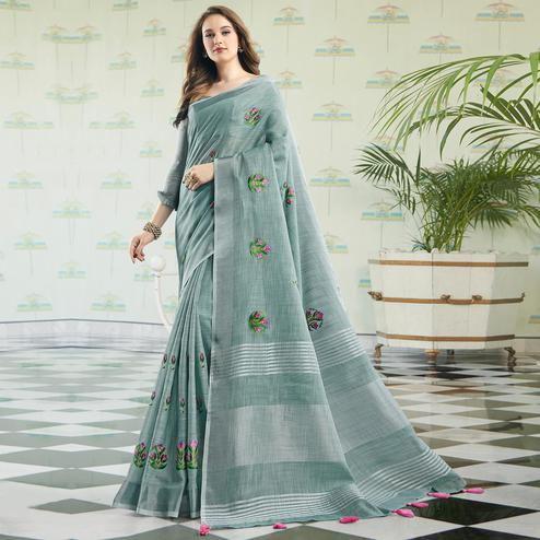 Intricate Pastel Blue Colored Party Wear Floral Embroidered Linen-Cotton Saree With Tassels