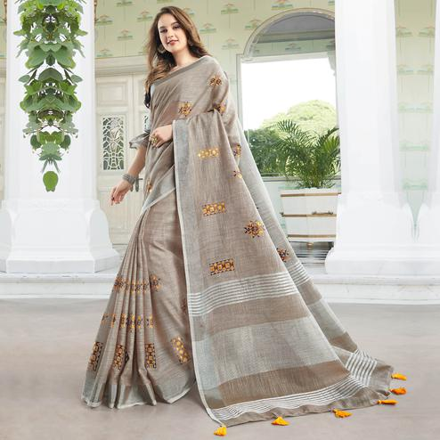 Classy Pastel Brown Colored Party Wear Floral Embroidered Linen-Cotton Saree With Tassels