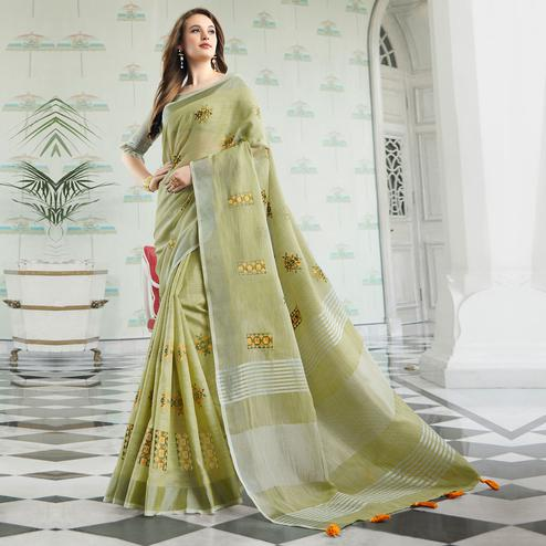 Arresting Pastel Green Colored Party Wear Floral Embroidered Linen-Cotton Saree With Tassels