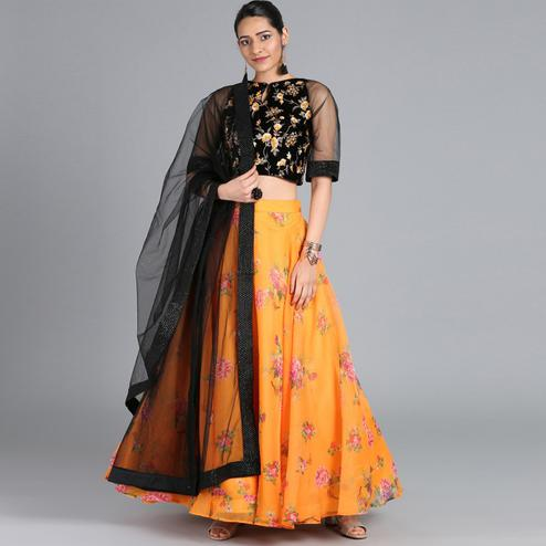 Fantastic Orange Colored Partywear Floral Printed Tissue Lehenga Choli