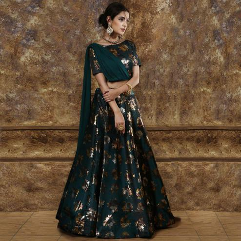 Eye-catching Teal Green Colored Partywear Foil Printed Tapetta-Satin Lehenga Choli