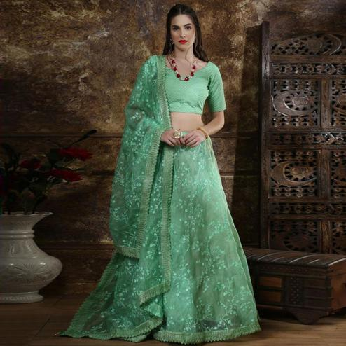 Blissful Turquoise Green Colored Partywear Embroidered Organza Lehenga Choli
