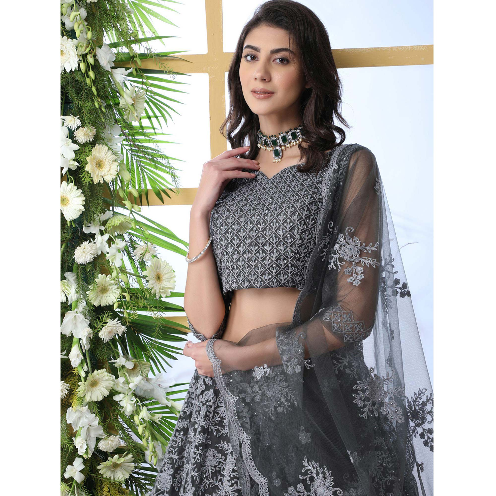 Prominent Grey Colored Partywear Embroidered Netted Lehenga Choli