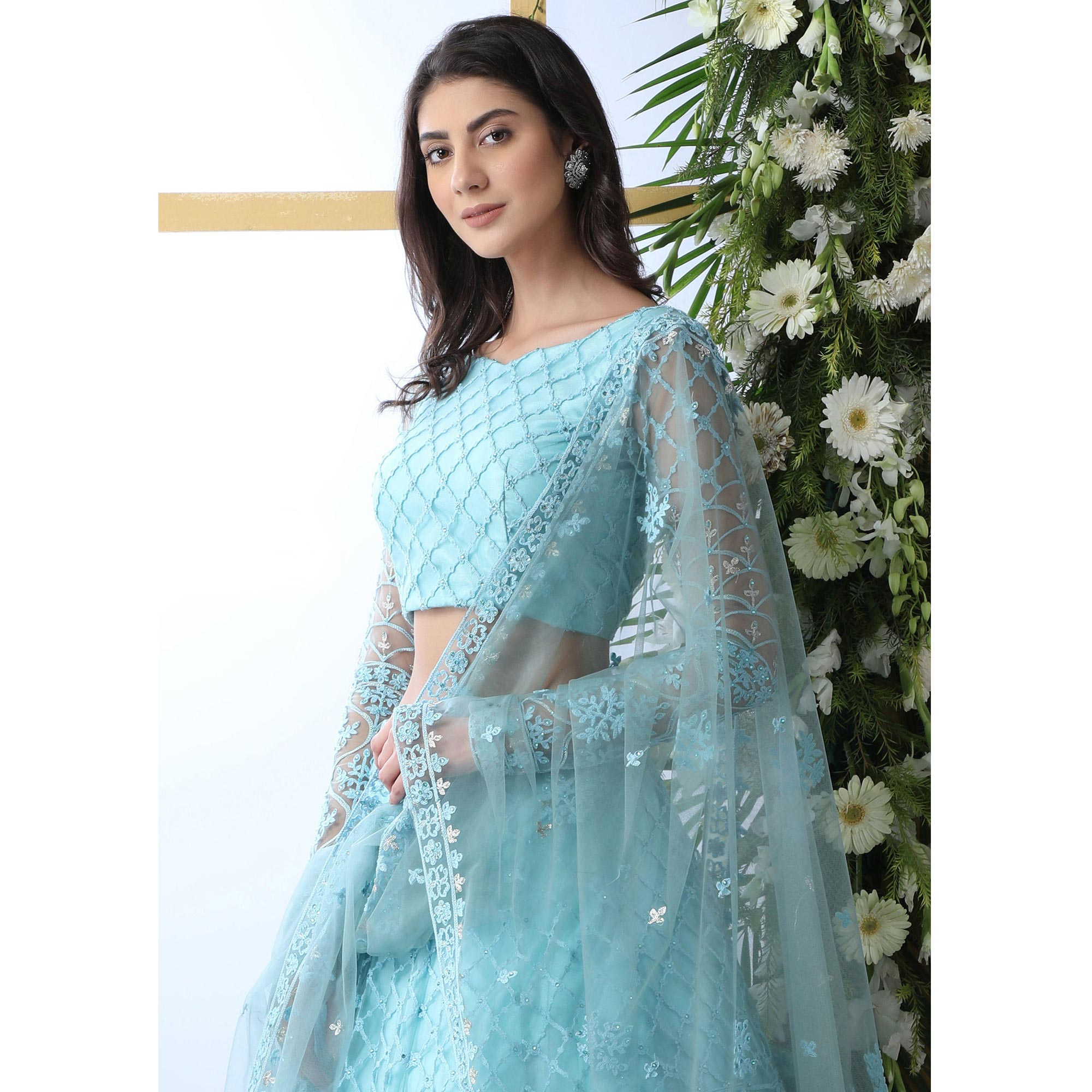 Capricious Sky Blue Colored Partywear Embroidered Netted Lehenga Choli