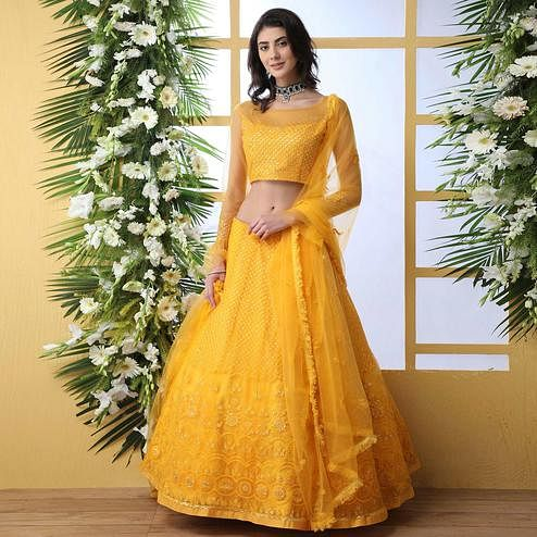Entrancing Mustard Yellow Colored Partywear Embroidered Netted Lehenga Choli