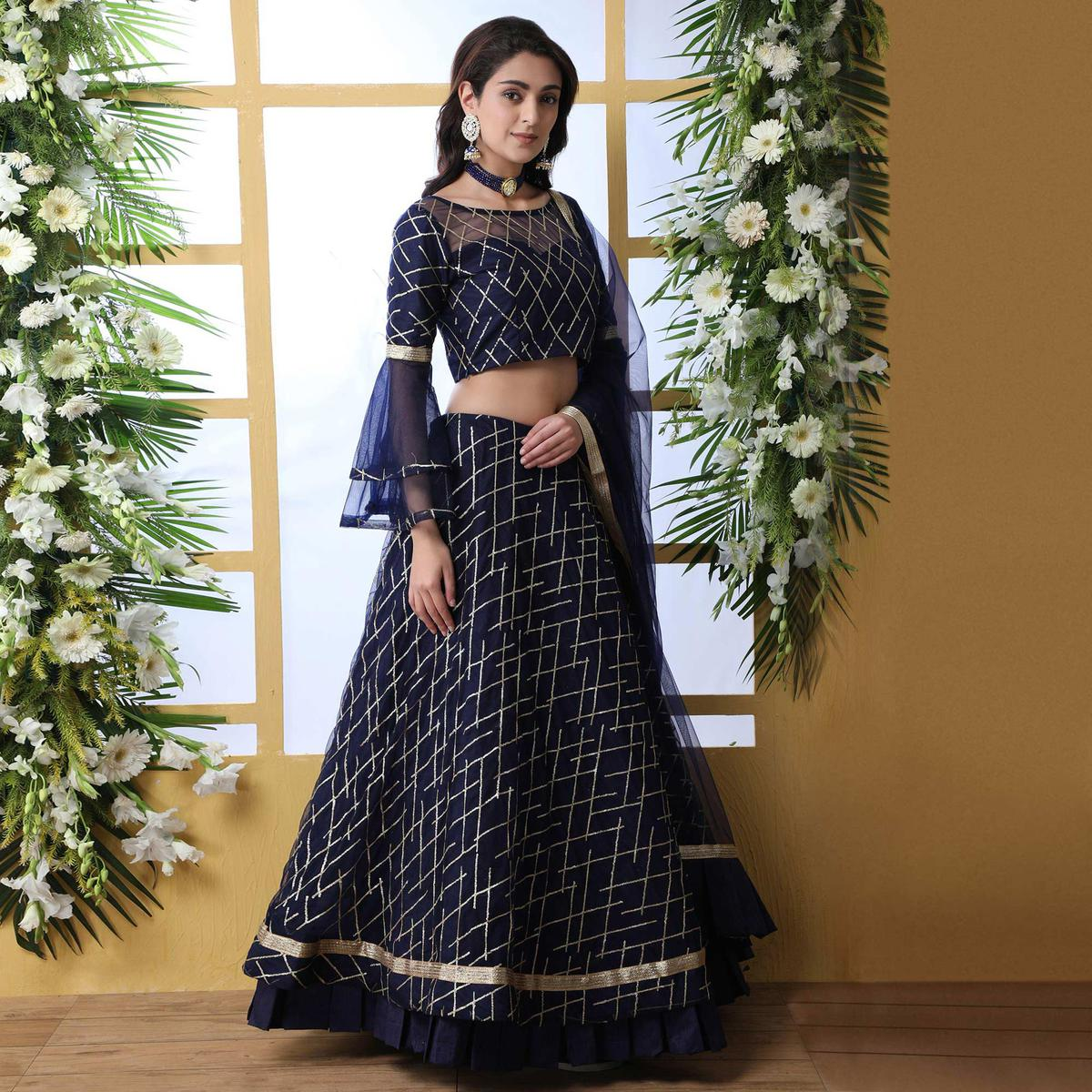 Adorning Navy Blue Colored Partywear Embroidered Netted Lehenga Choli