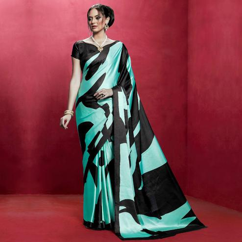 Pleasant Aqua Green Colored Casual Wear Printed Crepe Saree