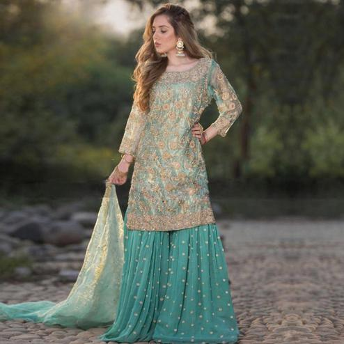 Elegant Sky Blue Colored Party Wear Embroidered Net Palazzo Suit