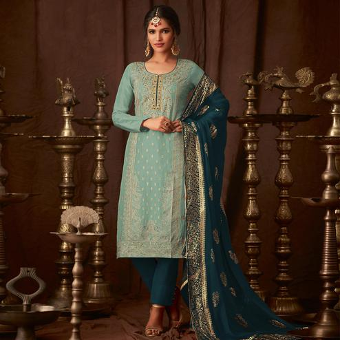 Exotic Aqua Blue Colored Party Wear Embroidered Georgette Straight Pant Suit